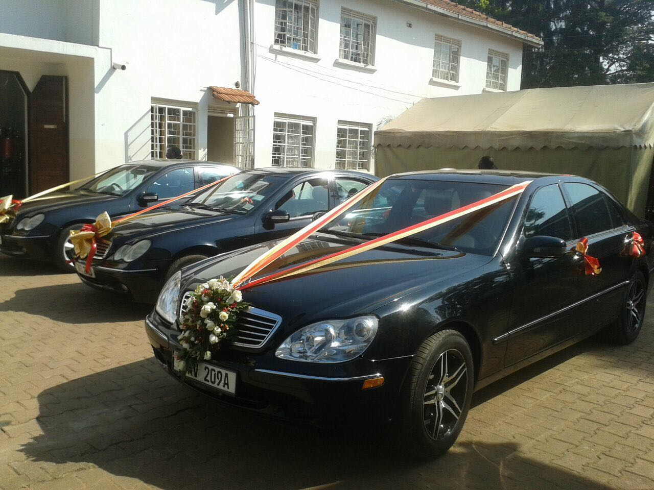 Black Mercedes benz packages for bride and groom entourage